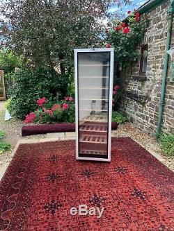 Bosch Wine Cooler. Tinted glass door and Oak Shelves. Holds up to 120 bottles